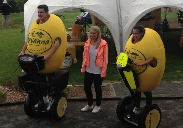 Lemon-suited cider-spiders - Segway PTs deliver Savanna Cider at Titirangi Golf Course