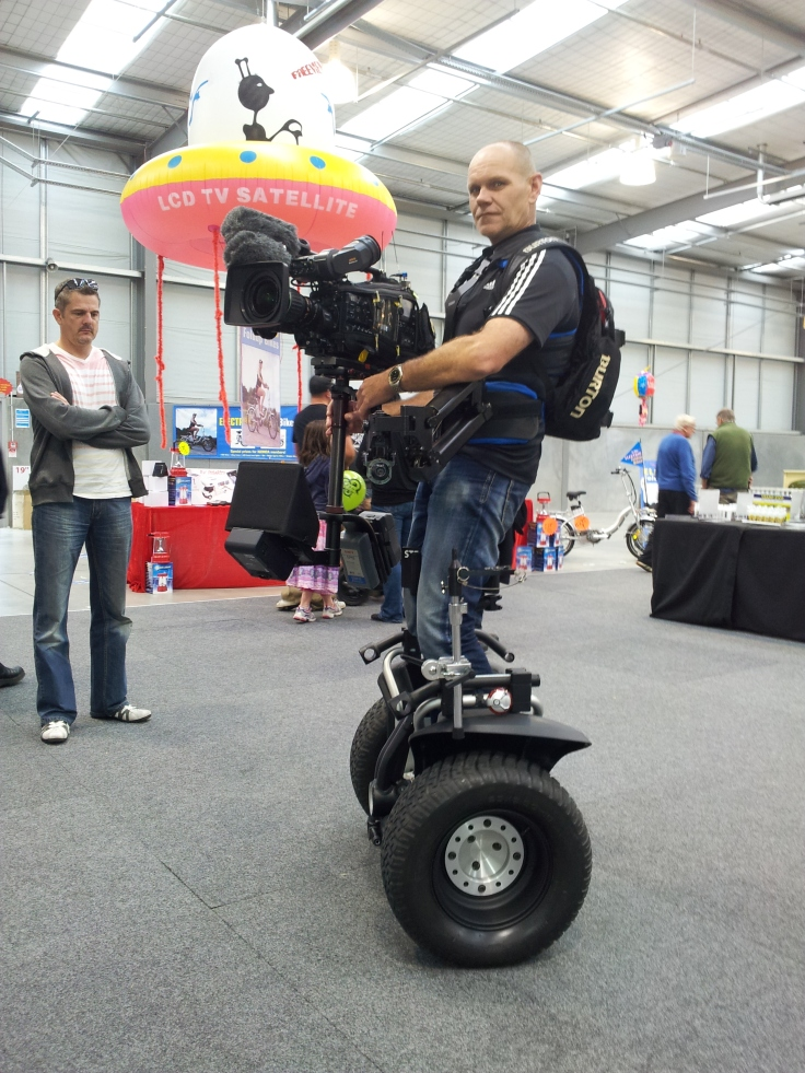 Geoffrey Andrew operating a camera rig mounted on his Segway x2 Turf