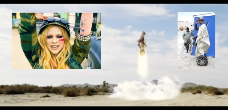 Avril Lavigne in Rock N Roll with Billy Zane lifting off on a rocket Segway PT