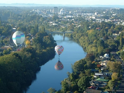 Balloons over the Waikato River flowing through Hamilton city.