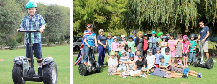 Photos: Dylan Schneider on his Segway XT and the pupils of Michael Park School, Auckland (c) Fairfax, reprinted from East & Bays Courier