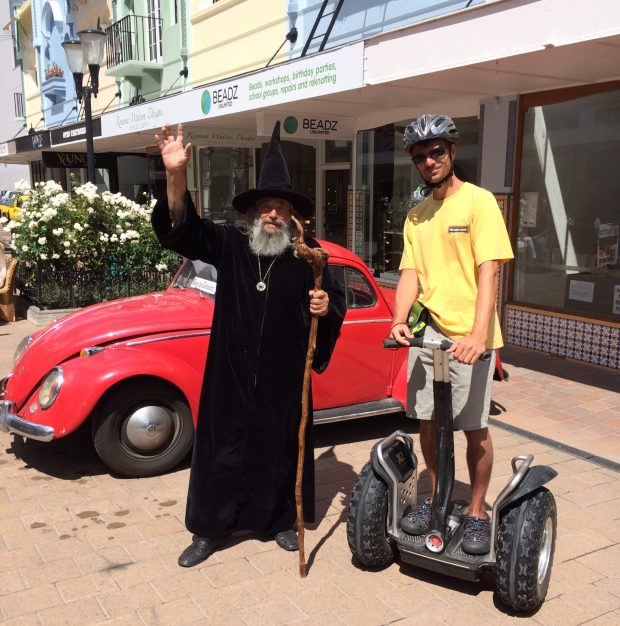 The Wizard of Christchurch with a Segway Tour participant, in front of his very special red VW Beetle….look carefully, it has two front ends!