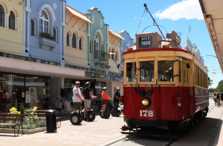 Christchurch Segway Tour riders give way to a tram on New Regent Street, illustrating the gentle mix of old and new in this part of town. Originally opened in 1932 and only reopened to the public post-earthquake last year, the Spanish Mission architecture style buildings and boutique shopping are a focal point for tourists visiting the CBD.