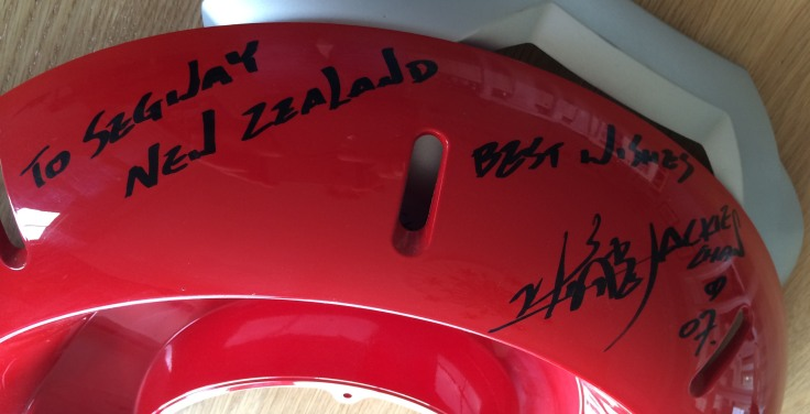 Jackie Chan signs a Segway Fender for Segway New Zealand