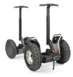 The Segway i2 SE (behind) and Segway x2 SE (front) model Personal Transporters.