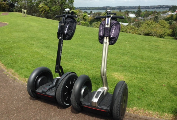 A new Segway i2 SE next to an original i2. Note the lower, cutaway centre console.