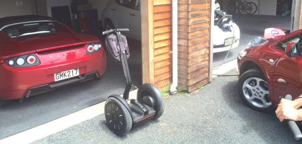The electric garage: Tesla Model S, Segway PT, and a pair of Nissan Leafs.